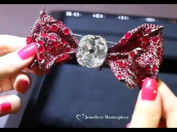 Bow tie brooch by Cindy Chao with 76 carat old mine cut diamond and rubies