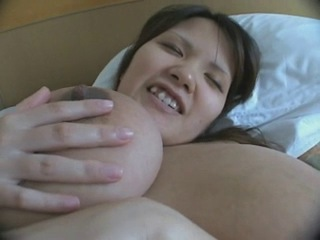 Humongous natural tits on this pregnant japanese