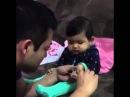 Папа стрижет ногти сыну