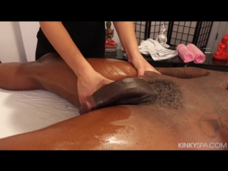 Young massage therapist works on her clients BBC