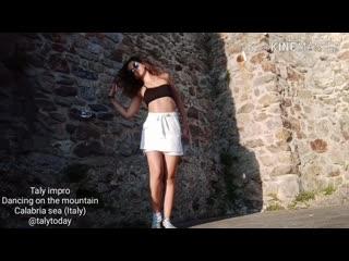 Taly. dancing on the mountain, calabria sea (italy)