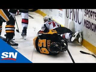 Penguins' jake guentzel crashes hard into boards after scoring goal