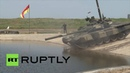 Amphibious Abilities: Military vehicles perform various water maneuvers during drills in Russia
