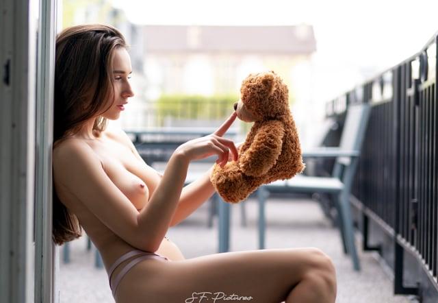 Gloria Sol sexy topless model hugging teddybear