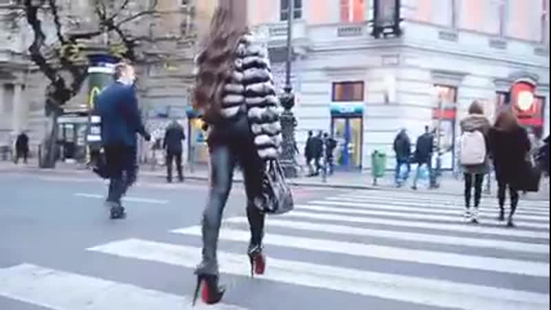 Most_sexy_girl_in_soft_leather_legging_walking_across_street_240p
