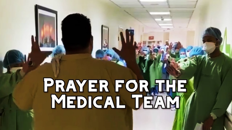 Pastor Prays for Medical Team in Philippines